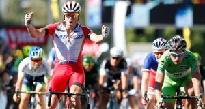 Alexander Kristoff (left) of Norway celebrates after crossing the finish line to win the 12th stage of the  Tour de France  from Bourg-en-Bresse to Saint-Etienne. Photograph: Bas CzerwinskI/EPA