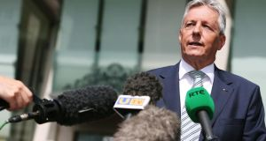 First Minister Peter Robinson speaks to the media outside the Stormont Hotel in Belfast yesterday, following the publishing of the Hallett review into controversial amnesties for on-the-run prisoners from Northern Ireland. Photograph: Brian Lawless/PA