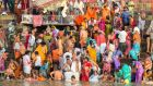 People come to wash and pray in the Ganges, a major source of pollution in Varanasi, India. Photograph: Graham Crouch/New York Times