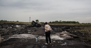 A woman looks at the wreckage of  Air Malaysia flight MH17 on July 18, 2014 in Grabovka, Ukraine. Photograph: Brendan Hoffman/Getty Images