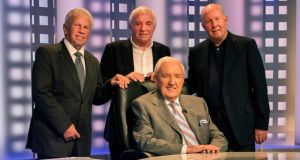 Retirement party:  Brady  (far left) with Bill O'Herlihy (seated), John Giles and Eamon Dunphy. Photograph: Steve Langan/INPHO