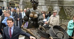 Minister for  Tourism  Paschal Donohoe at the unveiling today of the restored Molly Malone statue at its new location on Suffolk Street, Dublin. Photograph: Frank Miller/The Irish Times