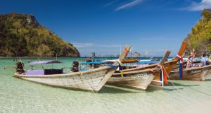 Longtailboats at a Thai tropical island. Give me the TV lounge.