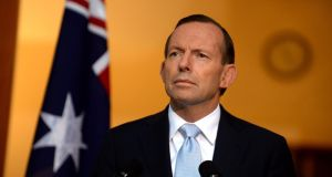 Australia's prime minister Tony Abbott at a press conference in Canberra. He said the crash made for  'a grim day for Australia', and looked more like a crime than an accident. Photograph: Alan Porritt/ EPA