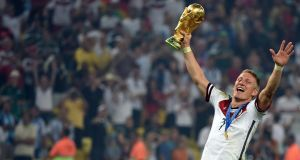 Midfielder Bastian Schweinsteiger, a key figure in Germany's triumph,  with  the World Cup trophy after last Sunday's victory in Rio. Photograph: Patrik Stollarz/AFP/Getty Images