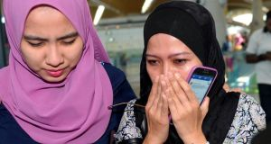 Relatives of passengers aboard Malaysia Airlines flight MH17 react at Kuala Lumpur International Airport. A total of 44 of the 298 killed in the crash, including the aircraft's 15 crew members, were Malaysian. Photograph: AP Photo