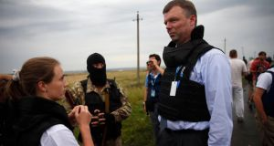 Organisation for Security and Cooperation in Europe (OSCE) monitors speak to  pro-Russian separatists at the crash site of Malaysia Airlines flight MH17, near the settlement of Grabovo in the Donetsk region of Ukraine. Photograph: Maxim Zmeyev/Reuters