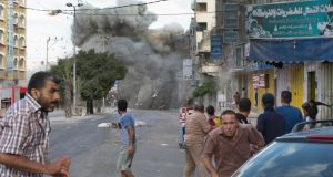 An Israeli bomb explodes in Gaza City today. Photograph: Tyler Hicks/The New York Times