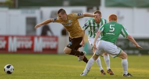 Shamrock Rovers' Dean Kelly eludes two Bray Wanderers defenders at the Carlisle Grounds. Photo: Donall Farmer/Inpho