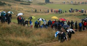 Spectators make their way around the course in the rain during day three of the British Open at Royal Liverpool. Photograph: David Davies/PA Wire.