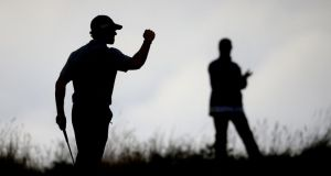 Rory McIlroy celebrates a birdie during day three of the British Open. Photograph: Peter Byrne/PA Wire.