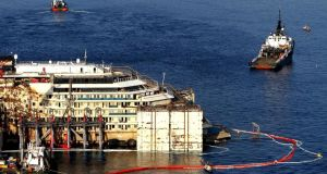 A view of the  works to refloat the wreck of the Costa Concordia cruise ship off the coast of Giglio Island, Italy. The Concordia's eagerly awaited departure from Giglio now seems set for Tuesday rather than tomorrow.  Photograph: Claudio Giovanni/EPA