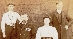 (From left to right) Frances, daughter of Jeremiah Hennessy snr (seated), his second wife Mary Josephine, and son Jeremiah jnr, who was involved in the Howth gunrunning.