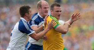 Monaghan's Ryan Wylie and Dick Clerkin with Donegal's Neil McGee. Photograph: Morgan Treacy / Inpho