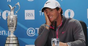Rory McIlroy of Northern Ireland answers questions from the media after his two-stroke victory at The 143rd British Open   at Royal Liverpool. Photograph:  Andrew Redington/Getty Images