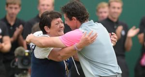 Rory McIlroy  of Northern Ireland celebrates with his mother Rosie   after winning the British Open Golf Championship at Hoylake. Photograph: Facyndo Arrizabalaga / EPA