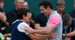 Rory McIlroy of Northern Ireland celebrates with his mother Rosie on the 18th green after winning the British Open Championship at the Royal Liverpool Golf Club. Photograph: Reuters