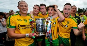 Donegal's Martin McElhinney, Christy Toye, Colm McFadden and David Walsh celebrate winning the Anglo-Celt Cup. Photograph: Russell Pritchard/Inpho/Presseye