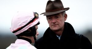 Paul Townend speaking with trainer Willie Mullins. Photograph: James Crombie/Inpho