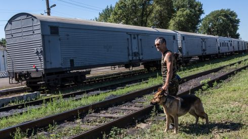 A pro-Russia rebel guards a train containing the bodies of victims. Photograph: Brendan Hoffman/Getty Images