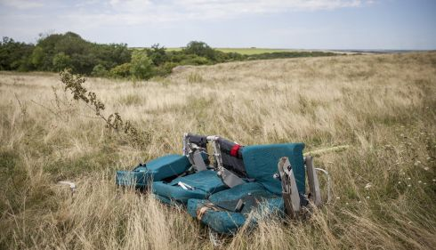 A row of seats lie in a field. Photograph: Rob Stothard/Getty Images