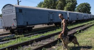 A pro-Russia rebel guards a train containing the bodies of victims of the Malaysia Airlines flight MH17 crash  in Torez, Ukraine. Photograph: Brendan Hoffman/Getty Images