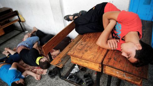 Palestinians sleep at a United Nations school, where people who fled heavy Israeli shelling in the Shejaia neighbourhood of Gaza City sought refuge. Photograph: REUTERS/Finbarr O'Reilly