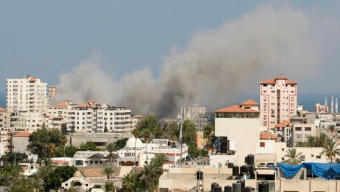 Smoke rises following what witnesses said was an Israeli air strike in Gaza City. Photograph: REUTERS/Mohammed Salem