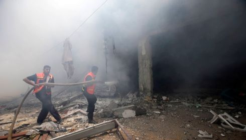 Firefighters extinguish a fire following a reported Israeli air strike. Photograph: REUTERS/Ibraheem Abu Mustafa