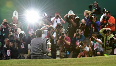 Rory McIlroy poses after his two-stroke victory in the British Open Championship. Photograph: REUTERS/Toby Melville