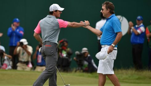 Celebrating his victory with caddie J.P. Fitzgerald on the 18th green. Photograph: REUTERS/Toby Melville