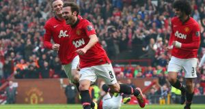Juan Mata  celebrates scoring  for Manchester United. Photograph: Alex Livesey/Getty Images