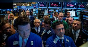 New York Stock Exchange traders: We are, according to one finance professor, biologically predisposed to screw up in our investment choices. Photograph: Brendan McDermid/Reuters