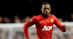 Patrice Evra has completed his move to Juventus from Manchester United.