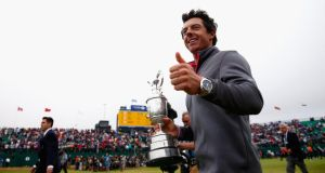 A happy Rory McIlroy gives a thumbs up to the crowd after his two-stroke victory at The 143rd Open Championship at Royal Liverpool  in Hoylake, England. Photo:  Tom Pennington/Getty