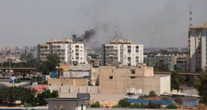 Smoke rises near buildings after heavy fighting between rival militias broke out near the airport in Tripoli over the weekend. REUTERS/ Hani Amara