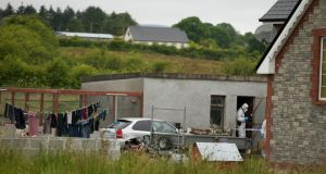 Gardaí from the Garda Technical Bureau at the house in Banada, Co Sligo, where the bodies of Shane and Brandon Skeffington were found yesterday. Photograph: Keith Heneghan