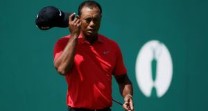 Tiger Woods tips his cap on the 18th green after finishing his final round of the British Open Championship at Hoylake. Photograph: REUTERS/Stefan Wermuth