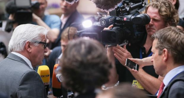 German minister for foreign affairs Frank-Walter Steinmeier (L) speaks to media as he arrives for a Foreign Affairs Council meeting at the EU Council headquarters in Brussels, Belgium. Photograph: Julein Warnand/EPA
