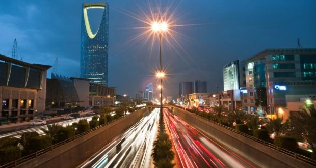Vehicle light trails pass the Kingdom Tower on King Fahad Road in Riyadh, Saudi Arabia. The country's market regulator said it will open the Arab world's biggest bourse to international investors by the middle of 2015. Photograph: Waseem Obaidi/Bloomberg