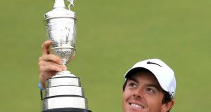 Northern Ireland's Rory McIlroy with the Claret Jug after winning the 2014 Open Championship at Royal Liverpool Golf Club, Hoylake.  Photograph: Peter Byrne/PA Wire.