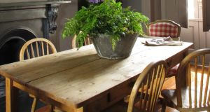 The scrubbed pine dining table and chairs came from a skip. Mac Gowan added a galvanised bucket filled with flowers from the Garden Shop at Mount Usher Gardens