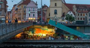 Erzherzog Johann bridge over the Mur River and City Beach cafe and bar along the riverbank. Photograph: Josef Polleross for The New York Times