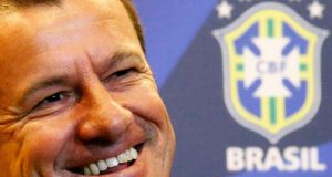 Brazil's new manager Dunga smiles during a news conference in Rio de Janeiro. Photograph:   Ricardo Moraes/Reuters