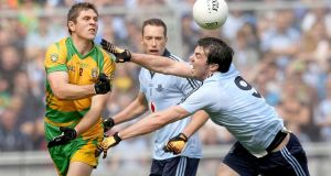 Donegal's Ryan Bradley and Michael Darragh MacAuley of Dublin during the sides' All-Ireland football semi-final at Croke Park in August 2011. Photograph: James Crosbie/Inpho.