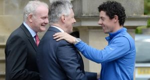 British Open winner Rory McIlroy is greeted by Northern Ireland's First Minister Peter Robinson and Deputy First Minister Martin McGuinness at Stormont Castle. Photograph: Charles McQuillan/Getty Images