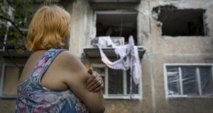 A local resident looks at an apartment building damaged by rocket fire  in Donetsk yesterday. Photograph: Rob Stothard/Getty Images