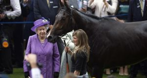 Britain's Queen Elizabeth II with her horse Estimate in the winner's enclosure after it wins the Gold Cup at Royal Ascot last year. Photograph: AFP Photo.
