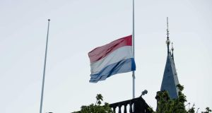The Dutch flag flies at half mast on the building of the Dutch parliament in The Hague, The Netherlands today for a day of national mourning. Photograph Bart Maat/EPA