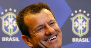 Brazil's new manager Dunga smiles during a news conference in Rio de Janeiro. Photograph:  REUTERS/Ricardo Moraes